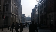 Photo looking between Georgian buildings in the sun with people between them